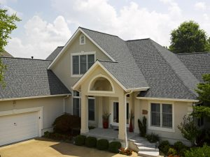 A modern two-story home with a new gray asphalt shingle roofing system.